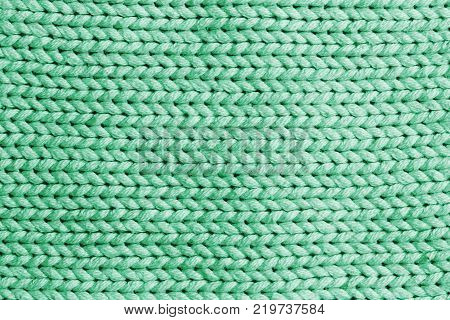Green horizontal line knitting fabric texture background or knitted pattern background for design. Knitting or knitted. Knitting pattern or knitted pattern for design. Small green knit texture or knit pattern.