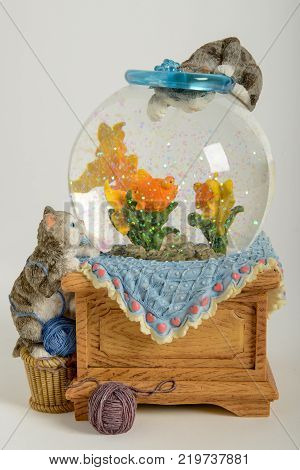 Lugano Switzerland - 21 December 2017: Beautiful snow globe with cats an fishes on white background
