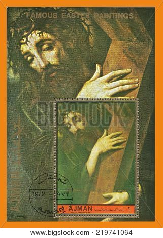 Ajman - circa 1972: Stamp printed by Ajman Color edition on Paintings Shows Jesus with the cross by Luis de Morales circa 1972