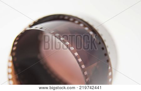A beautiful closeup of an analogue photo film on a white background. Shallow depth of field.