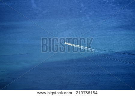 Motorboat sailing in the blue of the Atlantic Ocean off the coast of Lanzarote