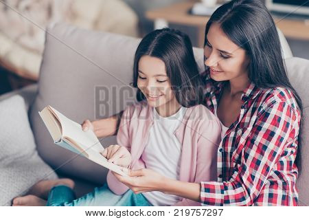 It's So Interesting And Exciting! Young Smiling Mother Is Reading A Funny Book For Her Cute Sweet Li