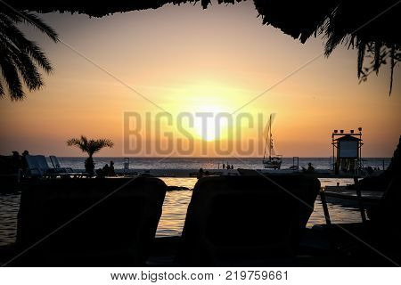 Travel photography - tropical sunset in a caribbean beach (Coche island, Venezuela).