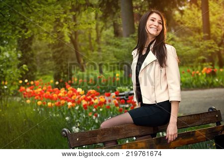 The Girl Sits In A Park On A Bench