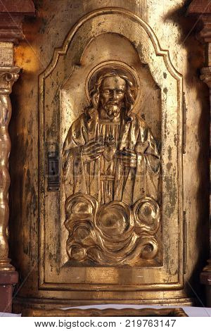 KLENOVNIK, CROATIA - AUGUST 30: Jesus, the door of the tabernacle on the altar in the chapel of the castle in Klenovnik, Croatia on August 30, 2005