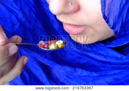 Asia women are taking and eating medicines and vitamins for help Sick and healthy.