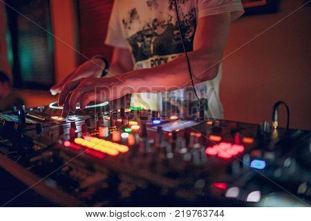 DJ playing music at mixer closeup club