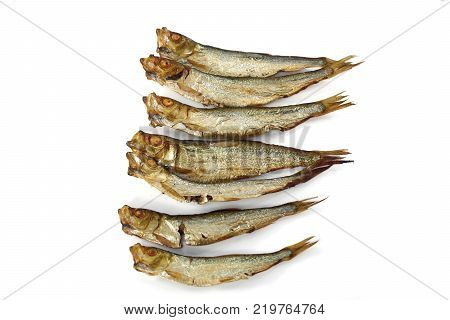 smoked whole sprats on  a  white background