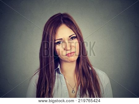 portrait of annoyed irritated young woman isolated on gray background