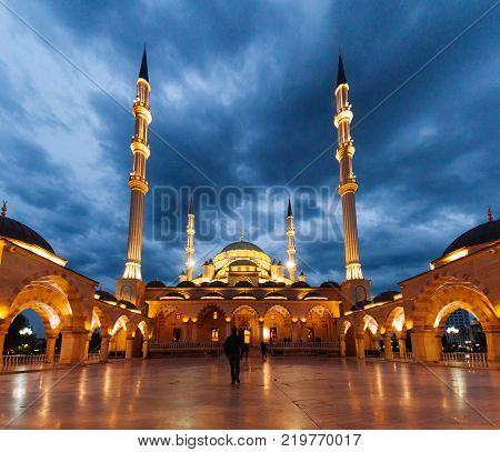 majestic mosque in the evening sky, glows