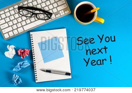See you next year - memo at blue office table. 2018 new year coming.