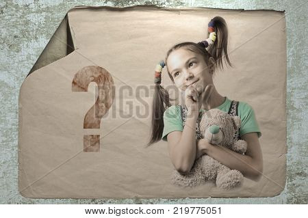 old paper ad on a cement wall with a portrait of a cute thoughtful girl with teddy bear toy next to the question mark. imitation of camera shake and light flashes.