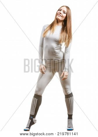 Clothing fashion sport concept. Fit female wearing thermoactive underwear full body shot. Slim woman in sporty clothes