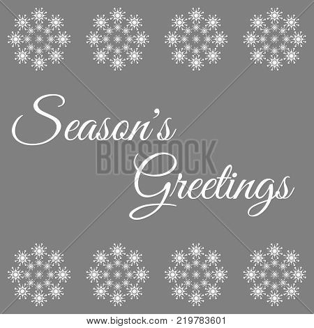 Season's greetings text in white with snowflakes