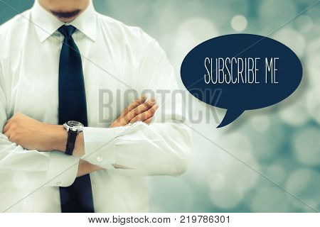 Register now subscribe advertising marketing membership concept. Businessman next to the chat bubble with text subscribe me. Businessman silhouette in bacground. Vintage filter applied.