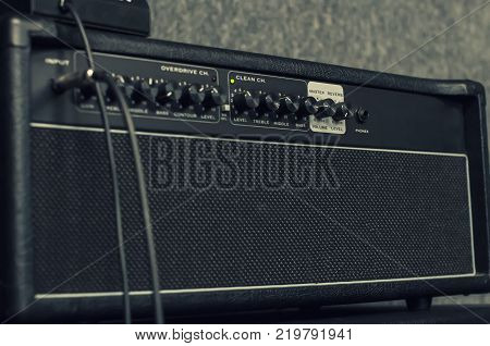 Guitar amplifier. electric tube amplifier for guitarist in record studio or live performance concert, rock, jazz, country, folk, pop, heavy metal, classic and more