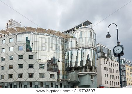 The modern architecture of Vienna with a glass facade.