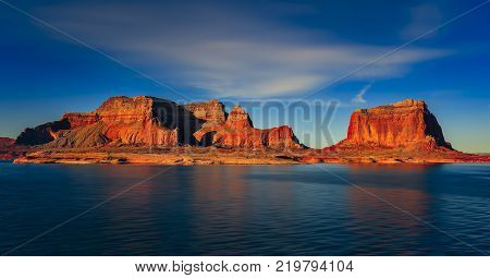 Beautiful canyon and lonely rocks on the Lake Powell Utah. Lake Powell is based on Colorado River with a great view on the canyoon.
