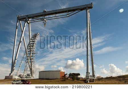 Gantry cranes, cranes bridge type, bridge superstructure which is mounted on a support moving on rails mounted on concrete foundations. The height of the crane 213, 25 feet