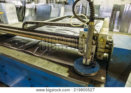 CNC programmable laser plasma cutting machine, modern industrial metalwork technology, professional manufacturing equipment poster
