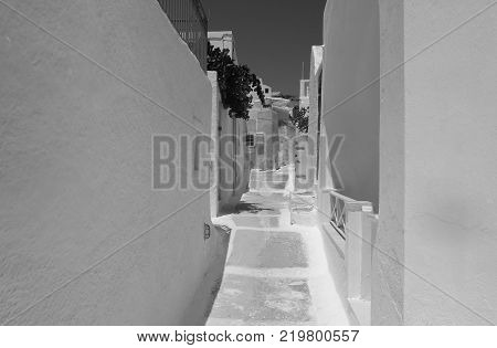 A hot summer afternoon on a narrow street in Emporio Santorini Island