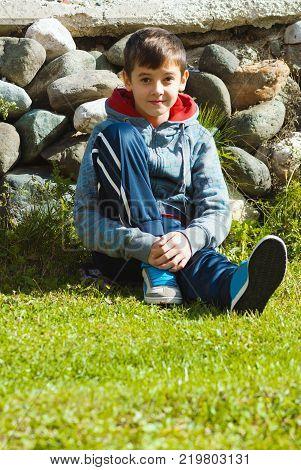 Beautiful Kid Enjoying Outdoor Sun At Summer Spring Season