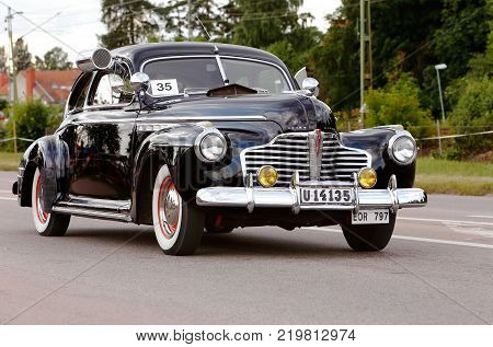 Vasteras Sweden - July 5 2013: One black Buick Sedanette 1941 during cruising parade at the Power Big Meet event
