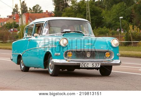 Vasteras Sweden - July 5 2013: One blue Opel Record 1958 during cruising parade at the Power Big Meet event.