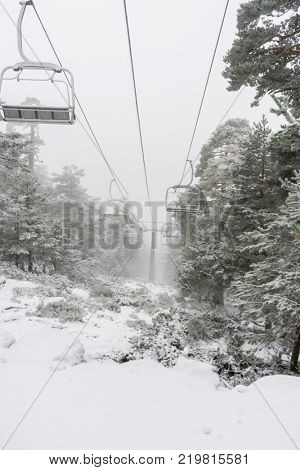 Snow, view of the chairlift for skiers in the practice of sky, Port of Navacerrada in Madrid, Spain.