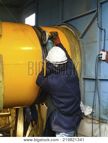 Safety at work. Welding and grinding of iron constructions. Industrial weekdays welders and fitters.