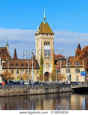 Zurich, Switzerland - 6 November, 2017: embankment of the Limmat river, the building of the Swiss National Museum in the background. Zurich is the largest city in Switzerland and the capital of the Swiss canton of Zurich.