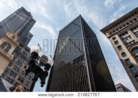 Boston Skyline - Towering Buildings seen from below on sunny day blue sky