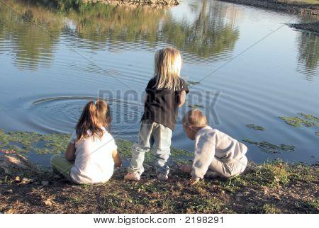Three Preschoolers At The Pond
