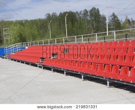 seat Empty tribune with on soccer stadium