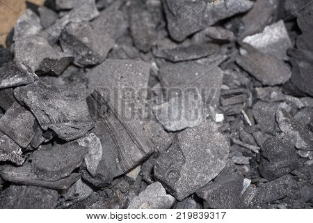 Coal mineral black cube stone background dark texture