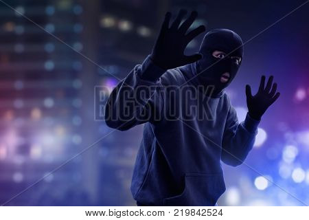 Masked thief caught on the street at night