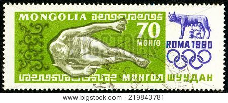 Ukraine - circa 2017: A postage stamp printed in Mongolia shows drawing High jump. Series: Summer Olympics 1960 Rome. Circa 1960.