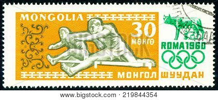 Ukraine - circa 2017: A postage stamp printed in Mongolia shows drawing Hurdles. Series: Summer Olympics 1960 Rome. Circa 1960.