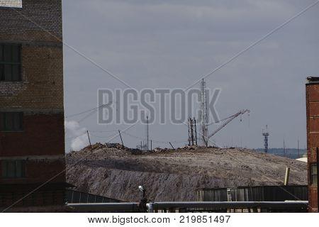 Salt production in the Saline With excavator and transportation belt conveyor sea salt is transported on salt hills.