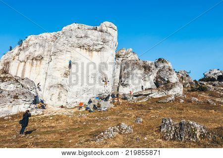 Poland Podlesice - March 04 2017: rock climbers on vertical flat wall. Gora Zborow is a very popular destination among climbers