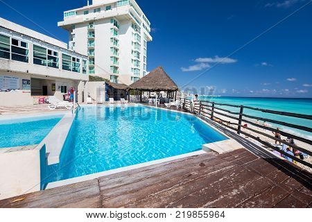 Mexico, Cancun - 16 January 2016: BelleVue Beach Paradise resort with swimming pool near sandy coastline