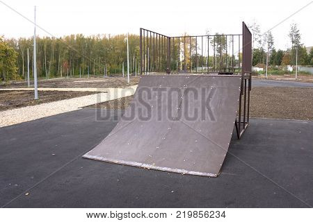 Outdoor skatepark with various ramps in green