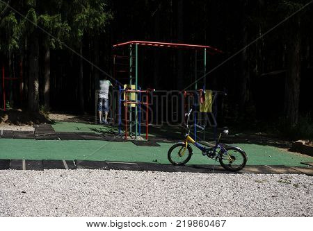 lifestyle transport communication and people concept - young man with bike