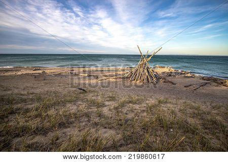 Lake Superior Beach Background. Wild and scenic shore of Lake Superior with rustic beach hut. Whitefish Point, Upper Peninsula, Michigan, USA