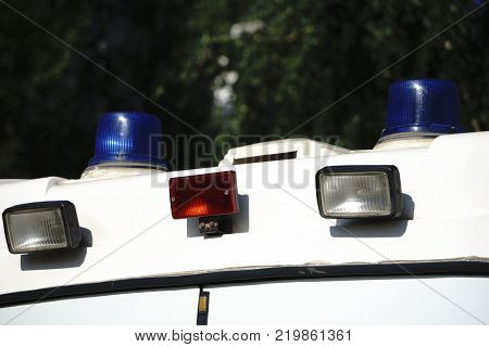 Roof mounted blue light bar police car grey black along