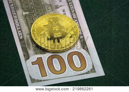 Bitcoin and the dollar. Symbol market BITCOIN cryptocurrency grows higher than the US dollar. Bitcoin over paper currency
