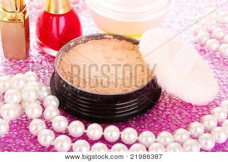 makeup powder on pink background