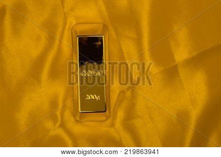 gold bullion on a yellow background around