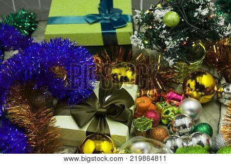 Christmas tree toys different colors balls gifts deer mask on a dark background Christmas New Year holidays preparation concept. Horizontal. Top view