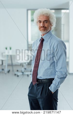 Confident Businessman Posing In The Office